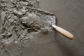 trowel with wet concrete