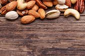 stock photo of pecan nut  - Background texture of assorted mixed nuts including cashew nuts - JPG