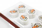 Japanese Cuisine - California Maki Roll made of Smoked Salmon, Cream Cheese and Deep Fried Vegetable
