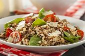 stock photo of quinoa  - Healthy Vegetarian Quinoa Salad with Tomatoes and Spinach - JPG