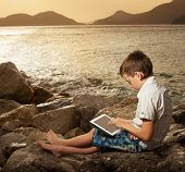 Child on the beach with tablet computer