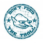stock photo of troll  - Blue grunge rubber stamp with a troll face and the text do not feed the troll written with capital letters - JPG
