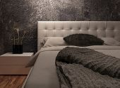 White huge bed standing against dark black wall