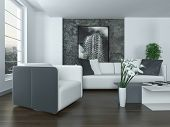 Modern grey and white living room interior with a comfortable upholstered lounge suite , large view window and modern art on the wall