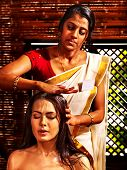 foto of ayurveda  - Young woman having head ayurveda spa treatment - JPG