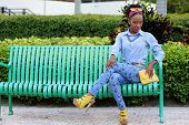 Jamaican model sitting in the park