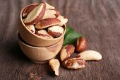 stock photo of brazil nut  - Tasty brasil nuts on wooden background - JPG