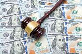 Gavel On A Background Of U.s. Dollars