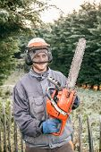 Professional Gardener With Chainsaw