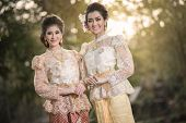 image of polite girl  - Two beautiful girls getting dressed in Thai Traditional Costume - JPG