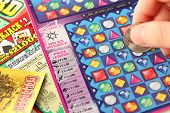Coquitlam BC Canada - May 25, 2014 : Scratching lottery tickets. The British Columbia Lottery Corpor