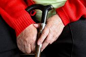 Old womans hands with cane