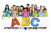 Diverse Cheerful Children Holding Letters