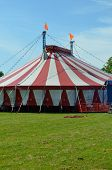 picture of circus tent  - Colorful circus tent on a village green ready for the performance to begin - JPG