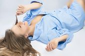 Happy Nice Caucasian Blond Woman In Blue Clothes Having Fun