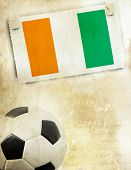 Vintage photo of Ivory Coast flag and soccer ball