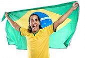 excited ecstatic fan celebrates and cheers with brasil flag for brazil football soccer world cup