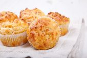 Savory Cheese And Bacon Muffins On The White Table