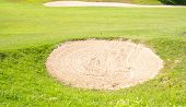 Sand Bunkers On The Golf Course.