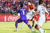 Sisaket Thailand-october 29: Sarawut Konglarp Of Army Utd. (no. 1) In Action During Thai Premier Lea
