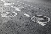 Sewer Manholes On Asphalt Road Pavement