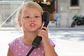 Girl Talking On The Street Phone