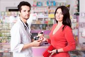 Pharmacist With Client Inside Pharmacy