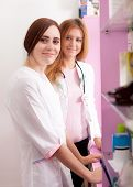 Two Pharmacist Woman Behind The Desk