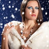 Sensual Woman In White Fur On Blue Background