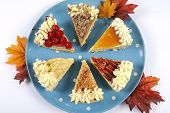 Thanksgiving Apple, Pecan, Cherry, Caramel, Pumpkin Spice And Chocolate Cream Cheesecake Pie, On Blu
