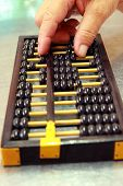 Abacus With Old Man's Hand