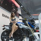 Model Posing On Bmw Motorbike At Eicma 2014 In Milan, Italy