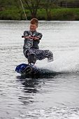 A young man wake-boarding / surfing