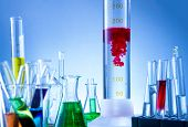 pic of liquids  - Laboratory equipment bottles filled with colorful liquids red liquid reacted - JPG