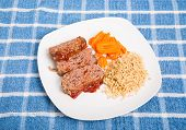 Sliced Meatloaf With Brown Rice And Carrots