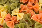 Bunch of the farfalle pasta three colors.