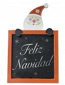 Christmas Blackboard written Merry Christmas (Spanish: Feliz Navidad)