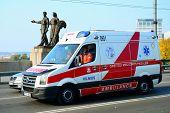 Ambulance Team In Vilnius City Over The Green Bridge