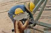 Construction welder welding metal