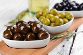 Different marinated olives on table close-up