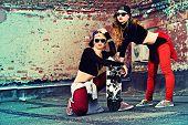 Modern hip-hop dancers over brick wall. Urban lifestyle.