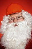 Portrait of Santa Claus - builder in helmet builder.