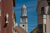 stock photo of hungarian  - Steeple in the old town of Sopron an hungarian town in the western transdanubia - JPG