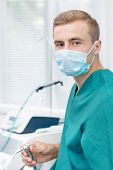 Young dentist in mask