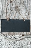 Chalkboard With Lacy Fabric And Dry Branch On Old Wood