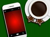 Christmas Coffee, Gingerbread And Mobile Phone Lying On Tablecloth
