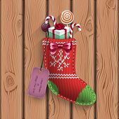 Christmas Sock With Gifts Suspended On The Wood Wall