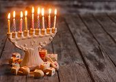 stock photo of hanukkah  - Jewish Holiday Hannukah Symbols - Menorah And Wooden Dreidels. Copy Space Background.