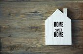 stock photo of wood design  - House Shaped Chalkboard sign Home sweet Home on rustic wood - JPG