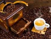 Coffee Grinder With Beans And Coffe Cup